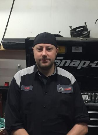 Glenwood Auto Service team member in the headlights - Sean Hill - Foreman at Glenwood